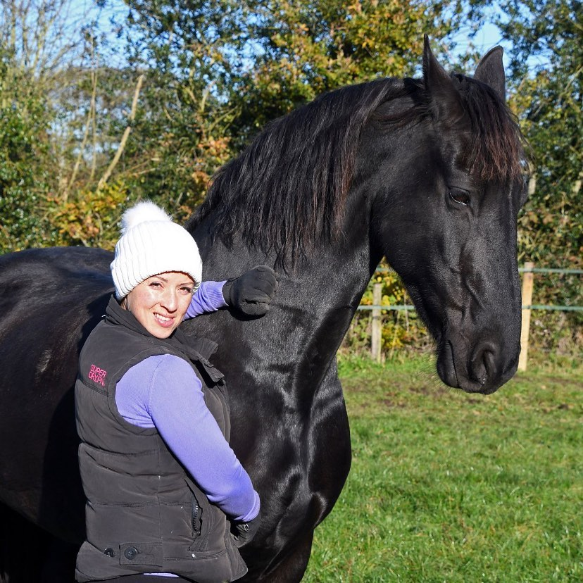 Clare, Founder of RiderCise with her Friesian Mare, Annick. The reason RiderCise exists today